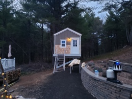 Shingling done, 80% of the roofing is done and solar front porch light installed!